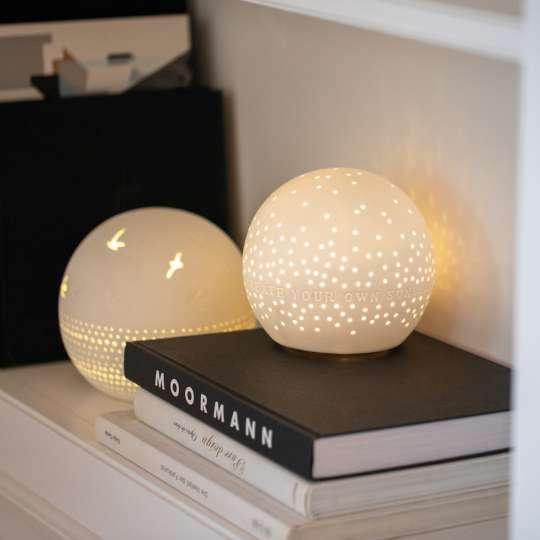 räder - Lichtkugeln - Bücherregal