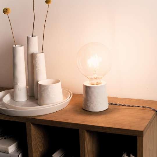 räder - Raumpoesie - verschiedene Vasen und Leuchte